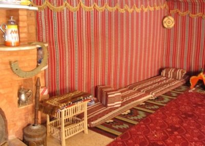Inside a Bedouin tent with celing, walls and floors made of wool rugs.-c