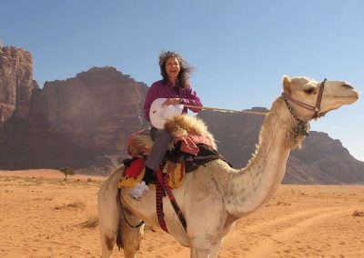 Jackie not enjoying a camel ride.-c