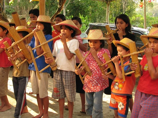 Orphanage children all playing flutes in Sulawesi