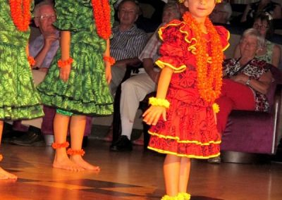 Youngest of group in training for hula dancing
