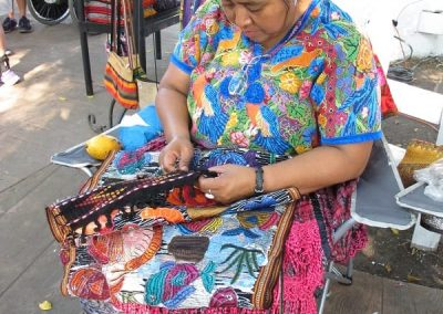 look at the embroidery in her huipil