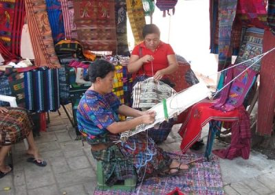 weaving and selling at the same time
